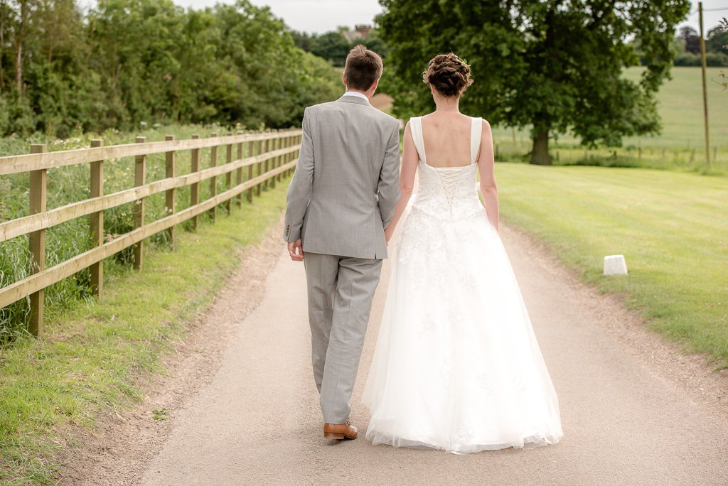 the married couple walk away from milling barn