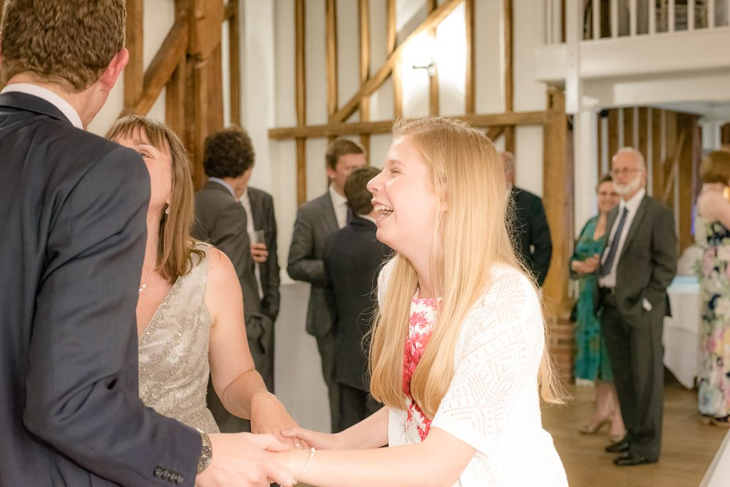 wedding guests dancing at milling barn