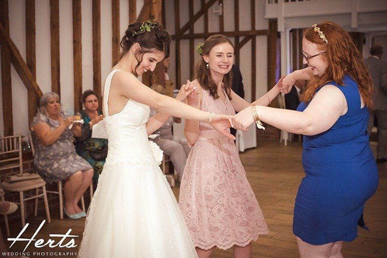 The bride dances with guests at her wedding