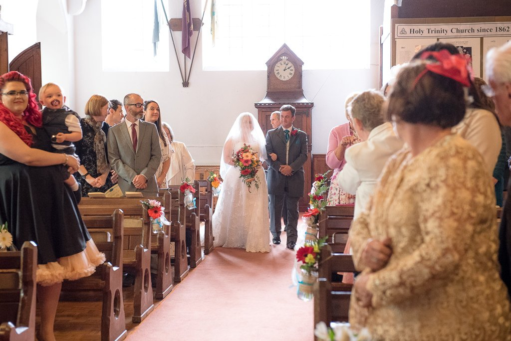 The bride enters the church