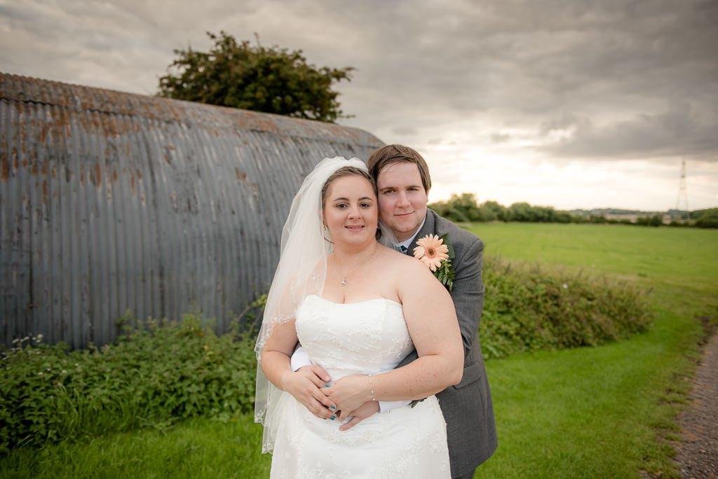 A bride and groom at milling barn