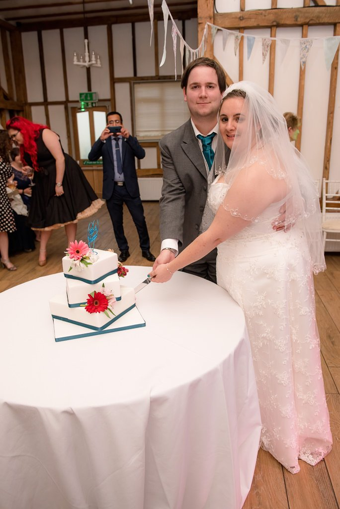 The cutting of the wedding cake