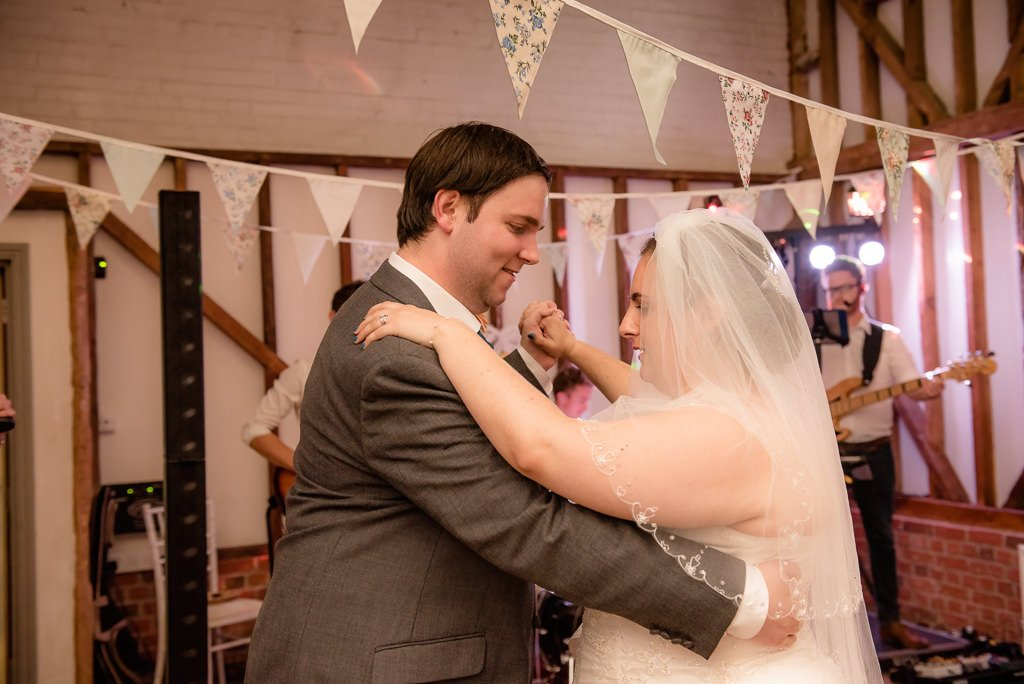 The bride and groom ballroom dance together