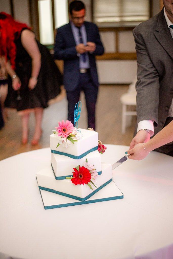 The couple cut the wedding cake