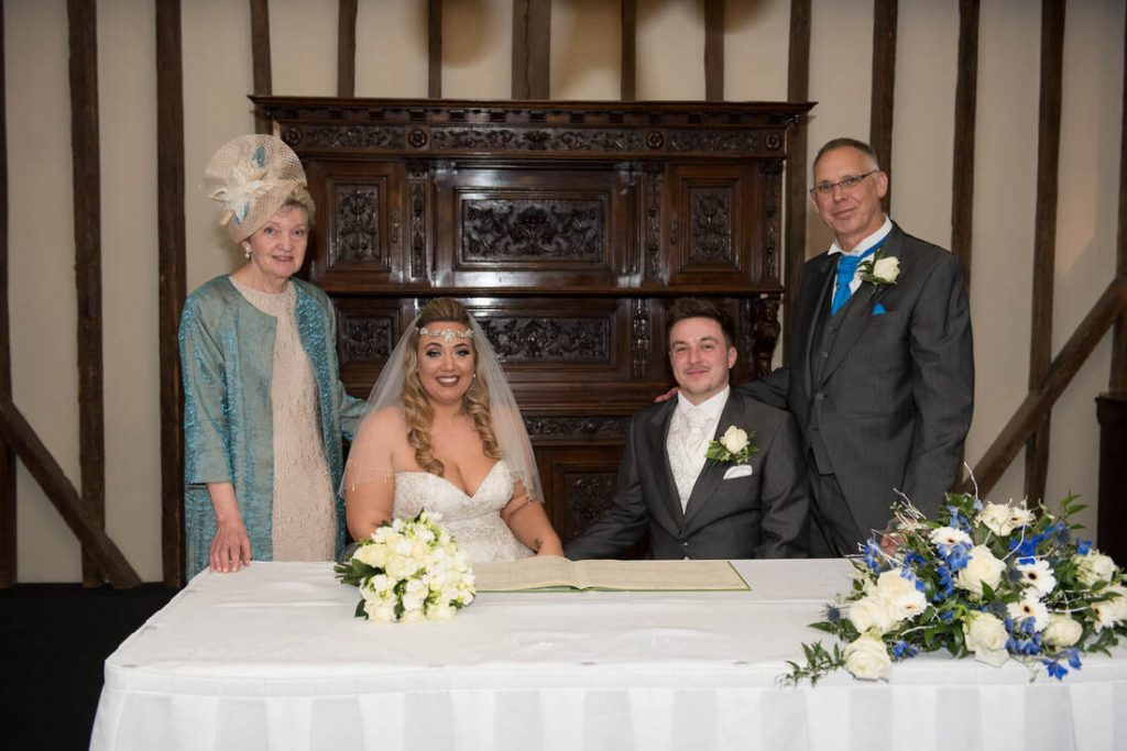 The signing of the wedding register with witnesses