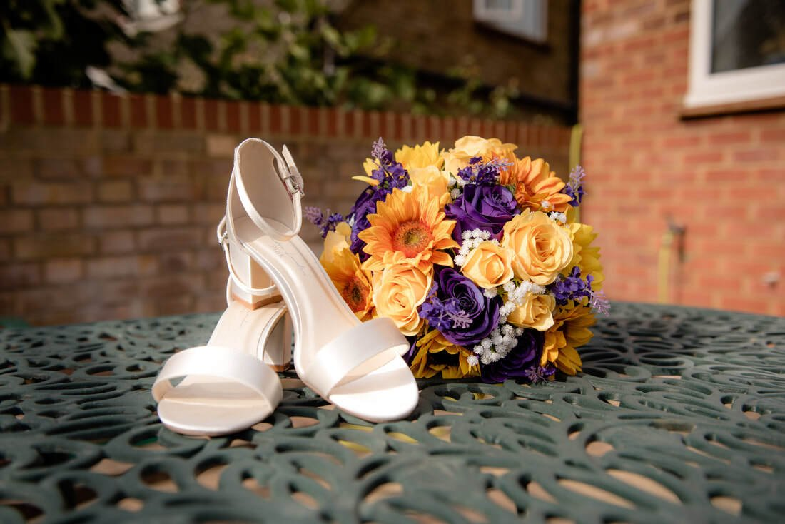 Wedding shoes and bouquet of flowers