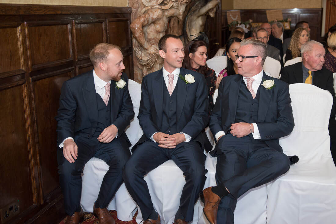 The groomsmen awaiting the arrival of the bride