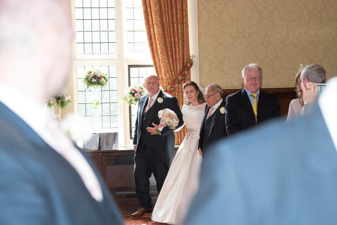 The bride being walked into the ceremony