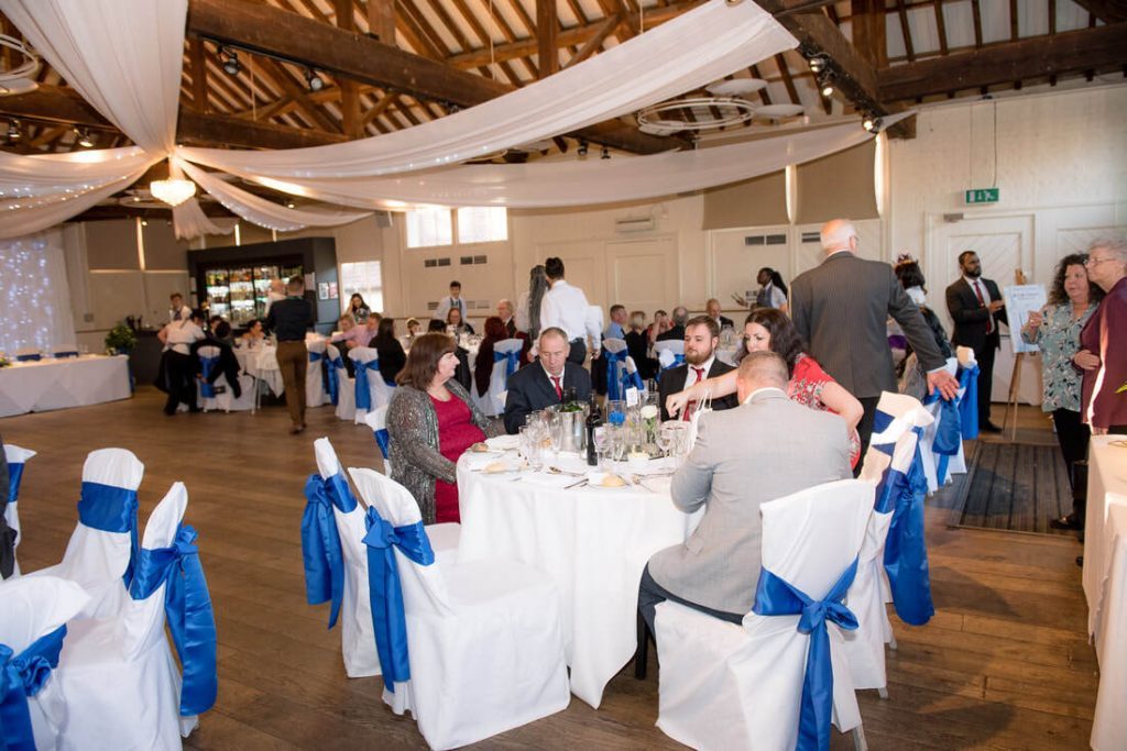 Guests sit down for the wedding breakfast at ridings barn