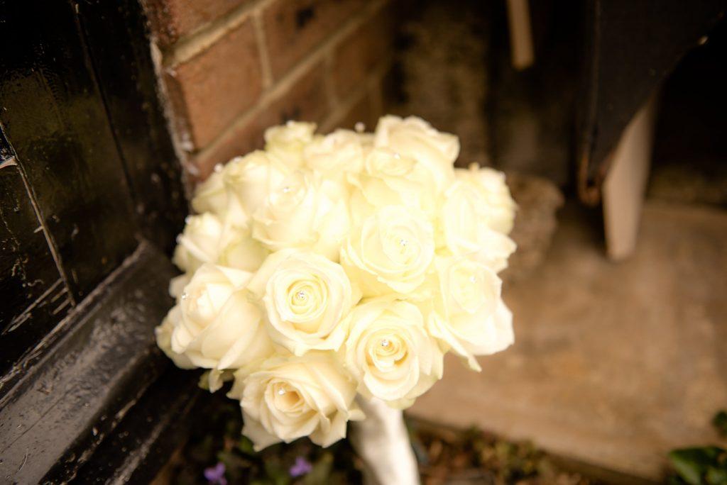 Bridal bouquet besides a black door