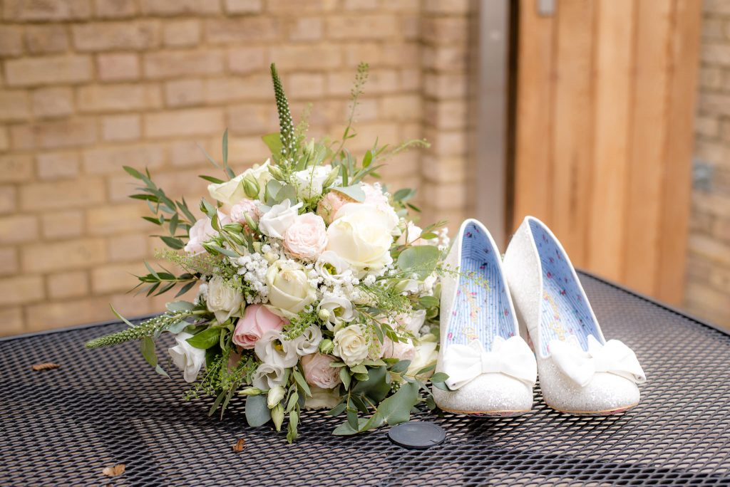 The wedding bouquet and Irregular Choice Wedding Shoes