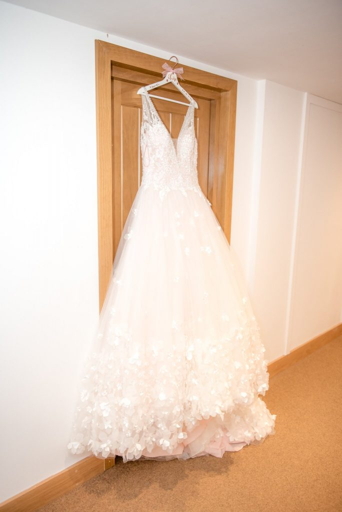 A wedding dress with pink detailing