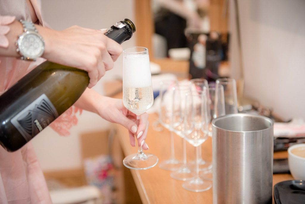 Prosessco being poured into a glass