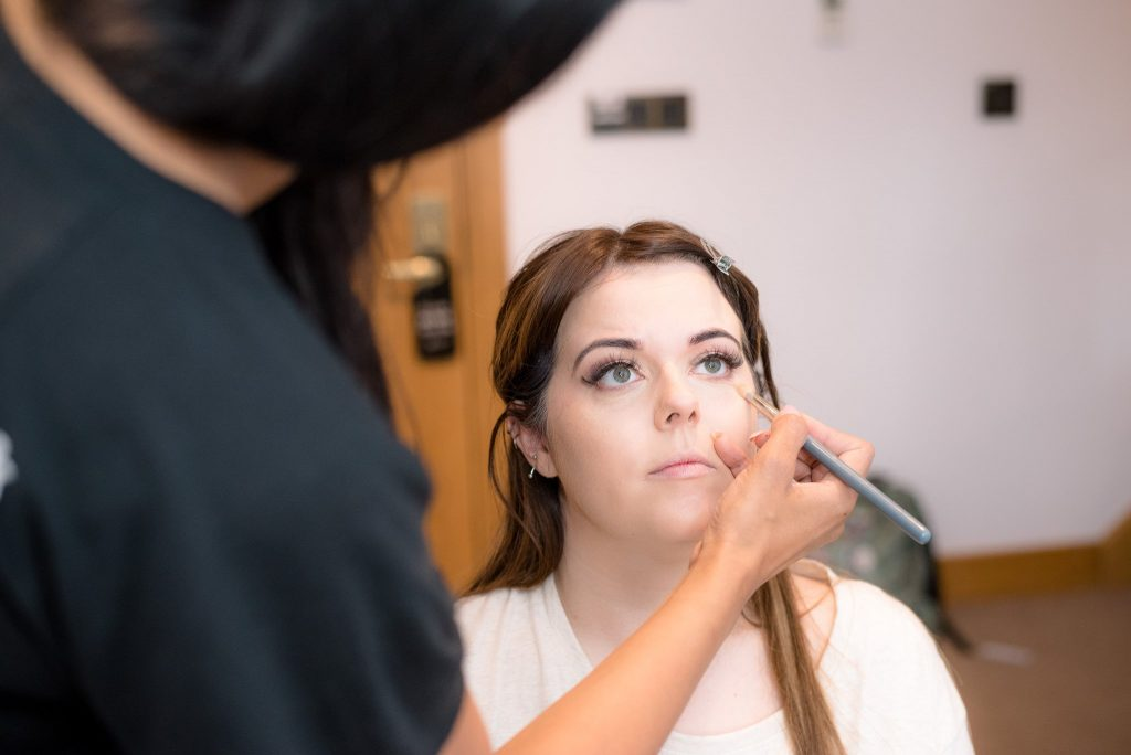 Wedding make up being applied to the bride