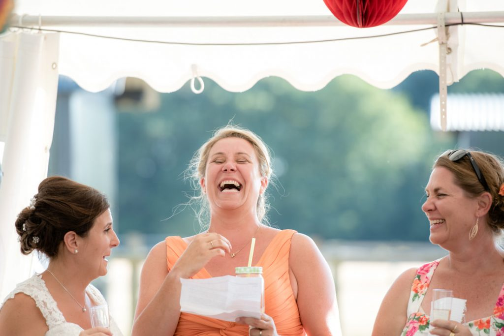 The bride laughs as she reads out her speech
