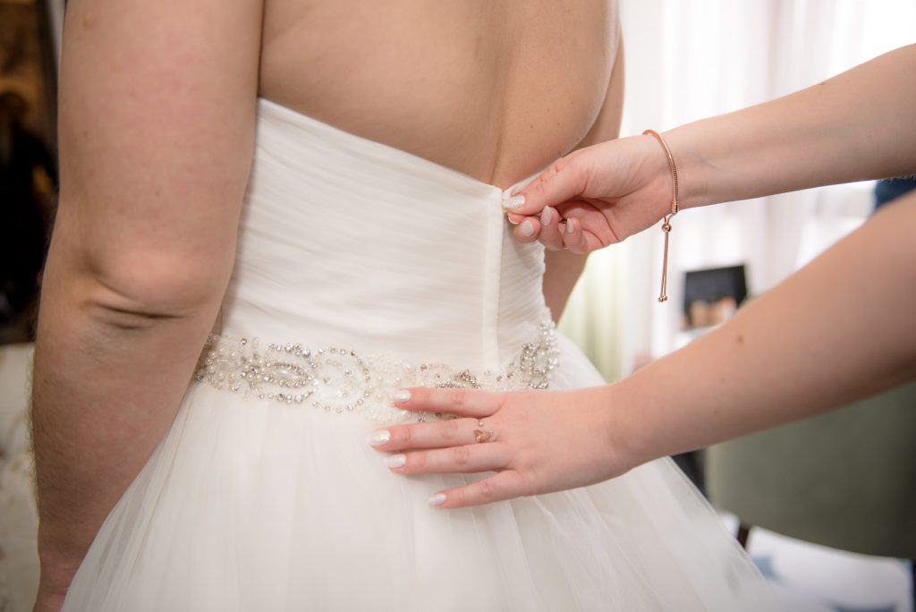The back of the wedding dress is zipped up