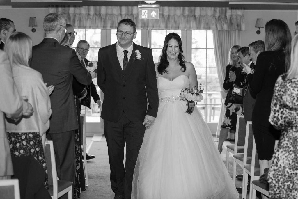The happy couple walk down the aisle