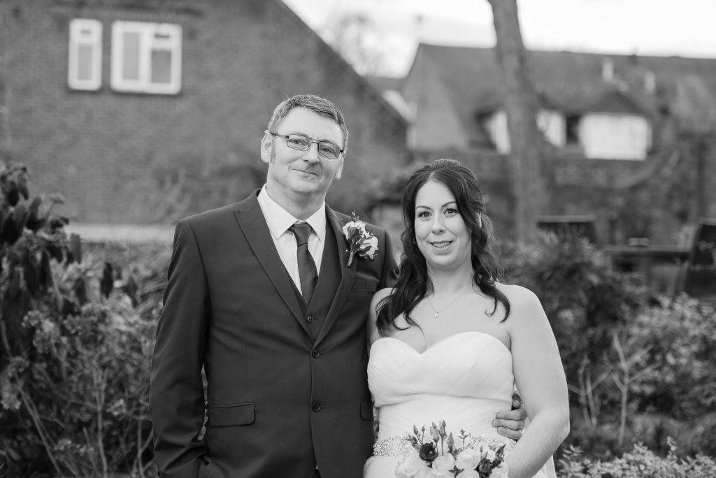 The bride and groom pose for a photo at the cromwell hotel stevenage
