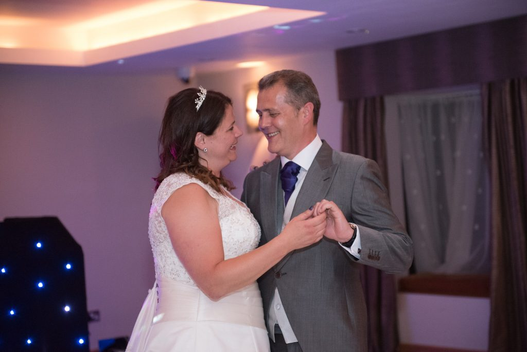 The bride and groom share their first dance together