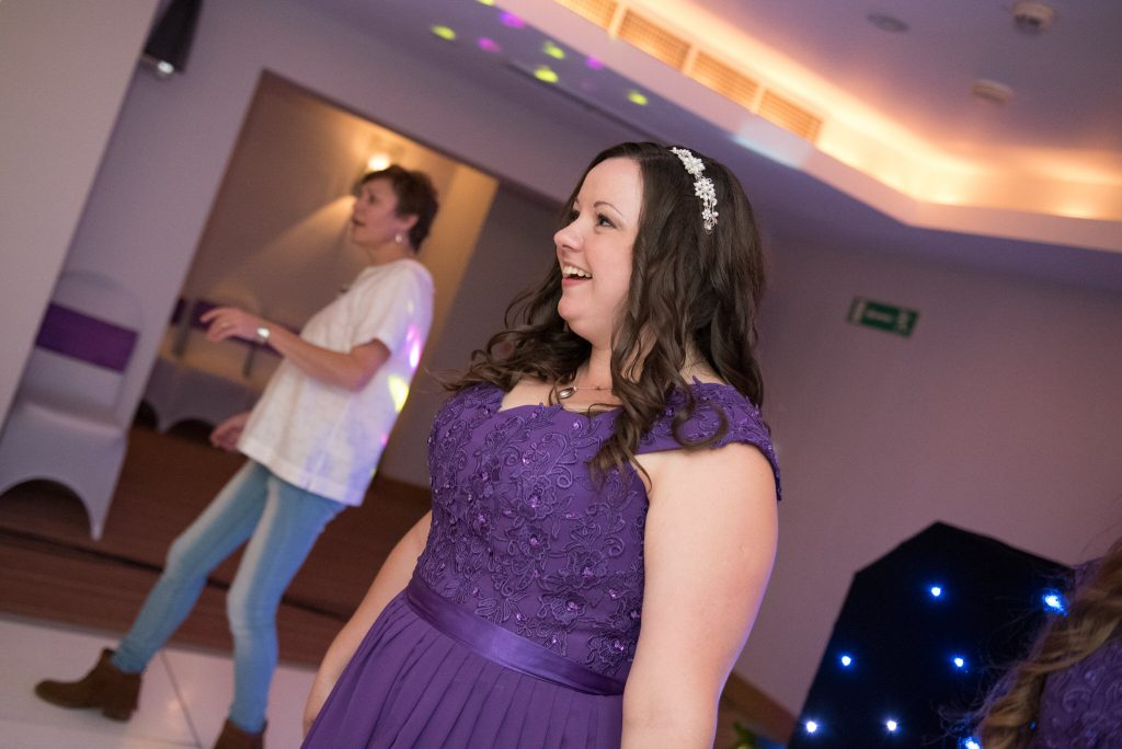 A bridesmaid dancing at the watermill hotel bourne end