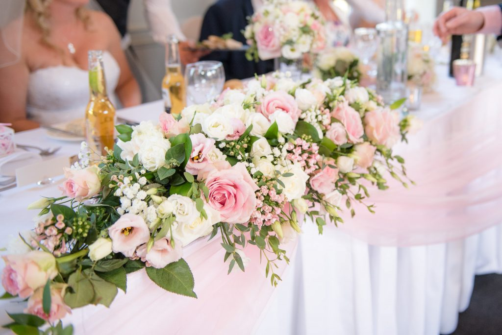 A large bouquet of flowers on the top table