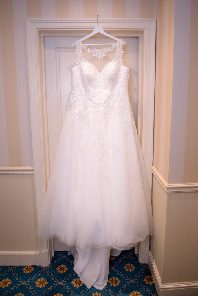 Wedding dress hanging from a door frame