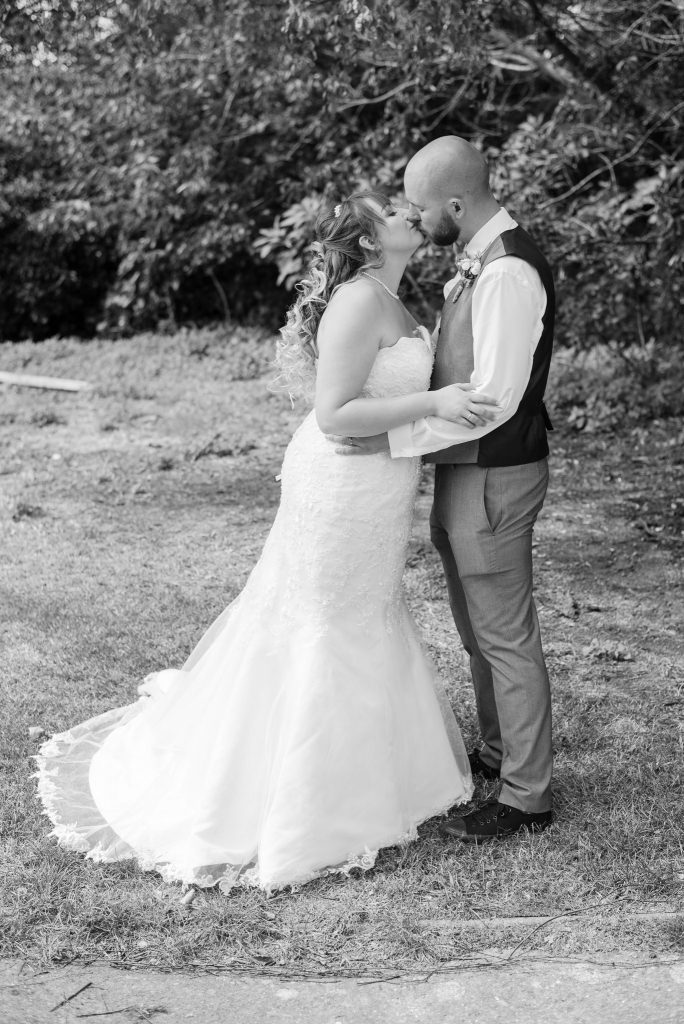 The bride and groom share a kiss together