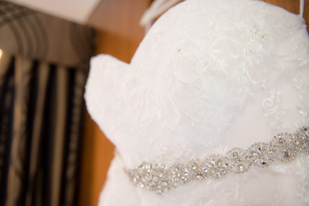 A close up photo of the wedding dress