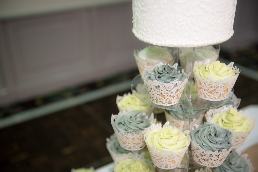 Wedding cupcakes on a clear stand