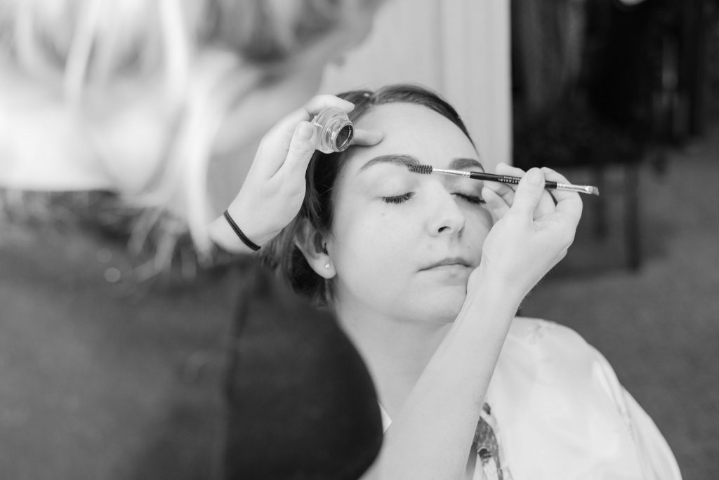 The bride having her makeup put on