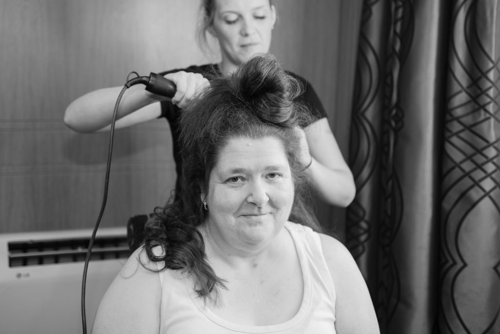 Mother of the bride having her hair styled