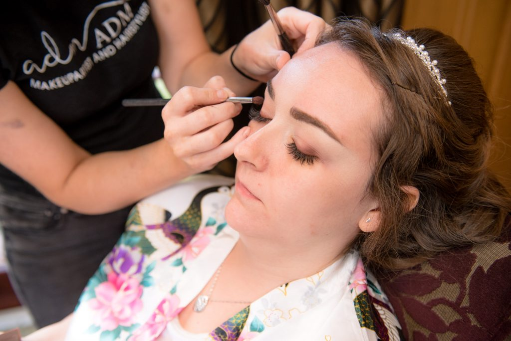 Eye shadow being applied to the bride