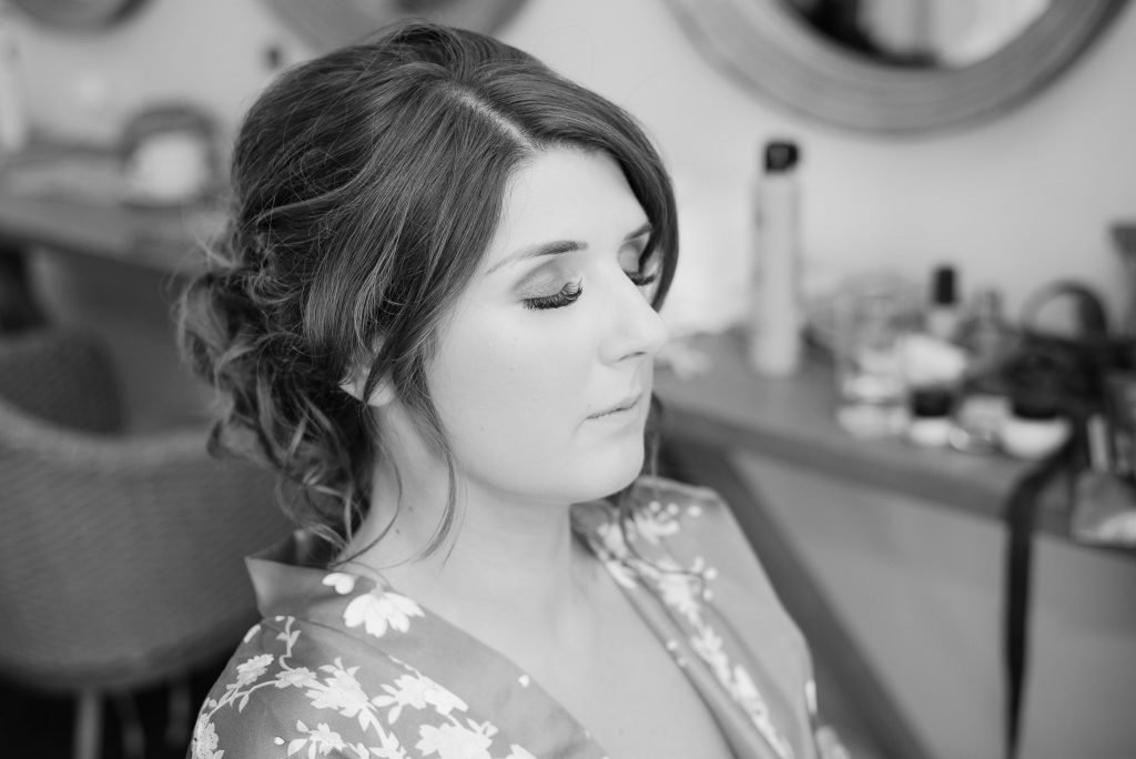The bride has her lashes attached