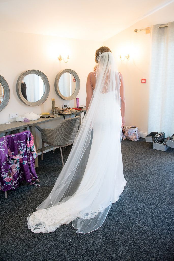 The back of the brides' wedding dress