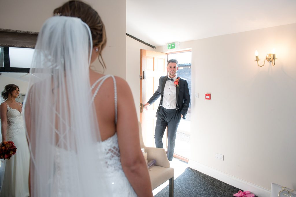 The brother of the bride sees his sister for the first time
