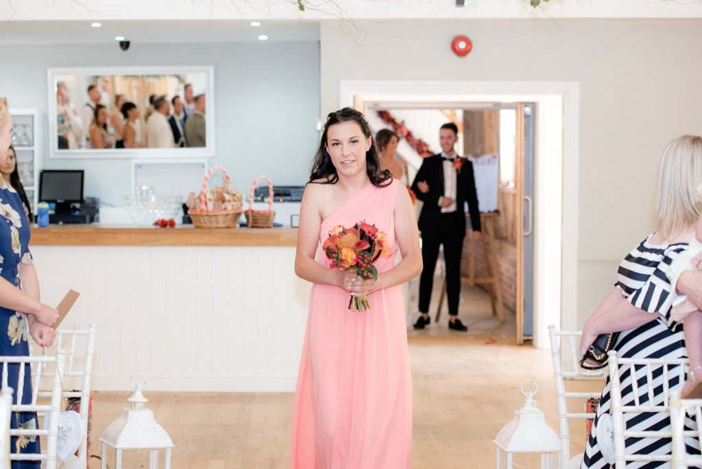 A bridesmaid enters the ceremony room