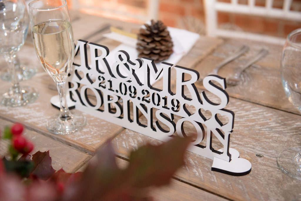 Mr and Mrs Sign on the top table
