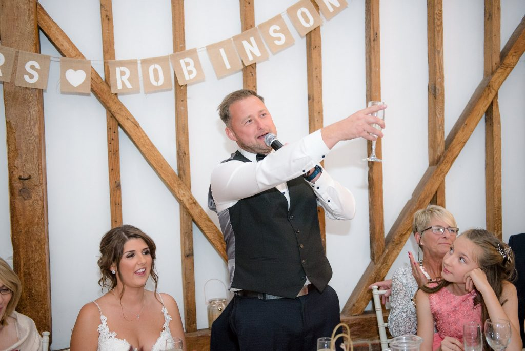 The groom toasts the wedding guests at milling barn