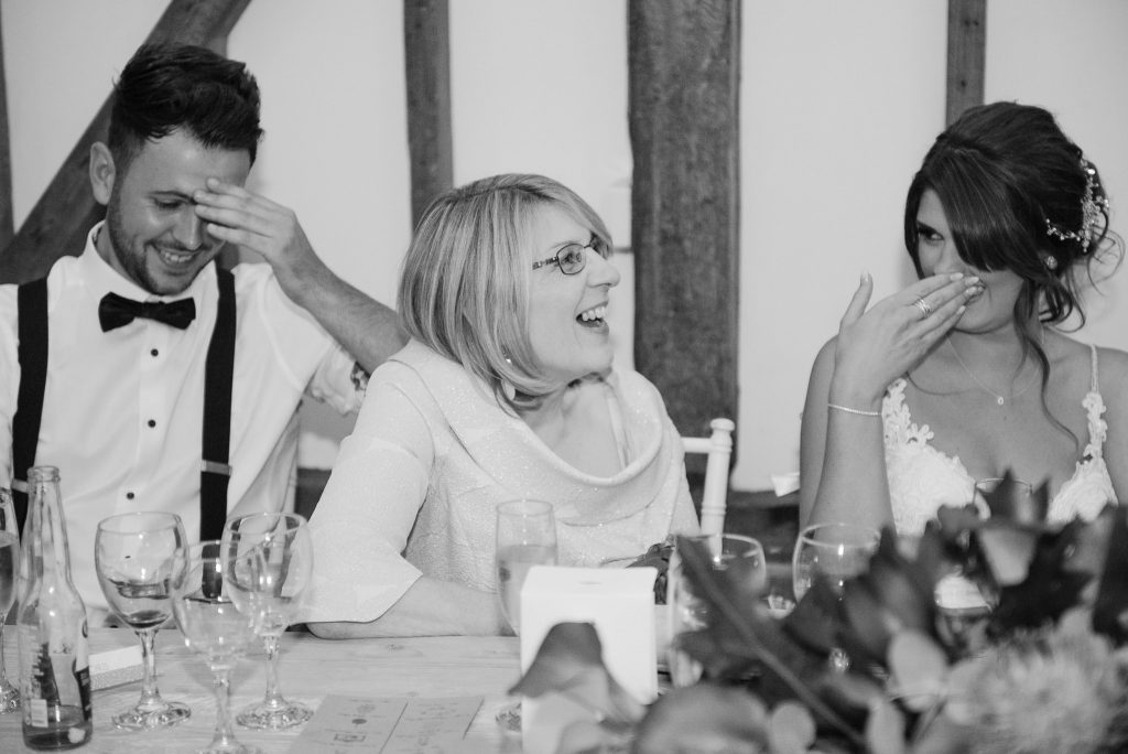 The mother of the bride has a joke with guests