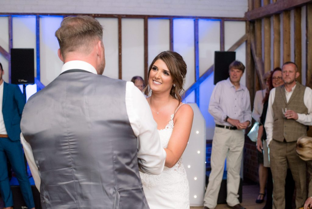 The bride and groom dance together at Milling Barn