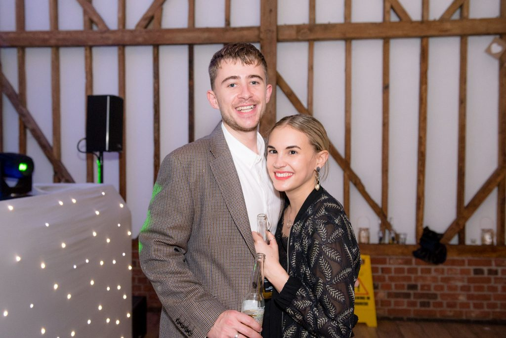 Guests pose for a photo at milling barn