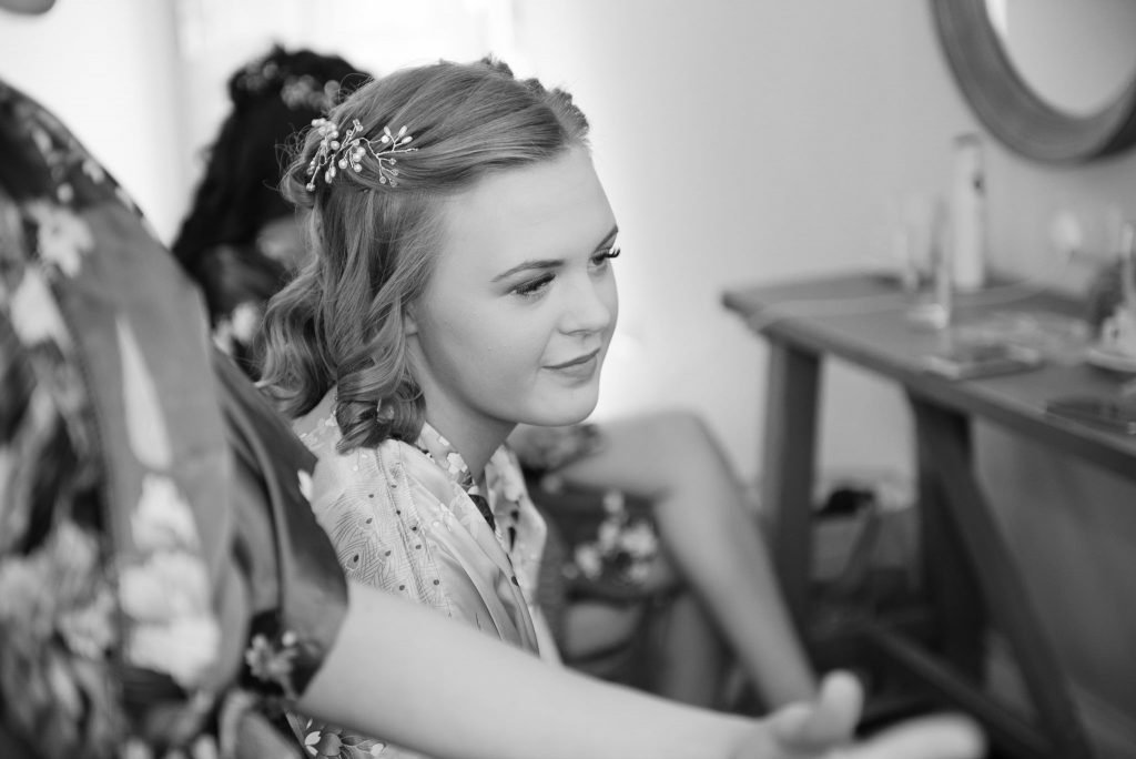 A bridesmaid sits in the dressing room
