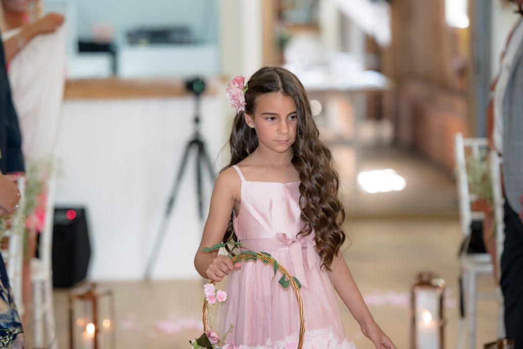 A flower girl spreading petals