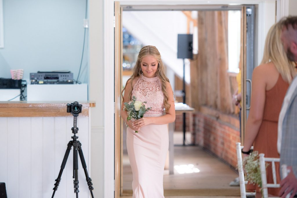 The daughter of the bride leading the entrance
