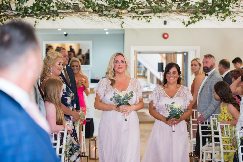 The bridesmaids entering the ceremony room
