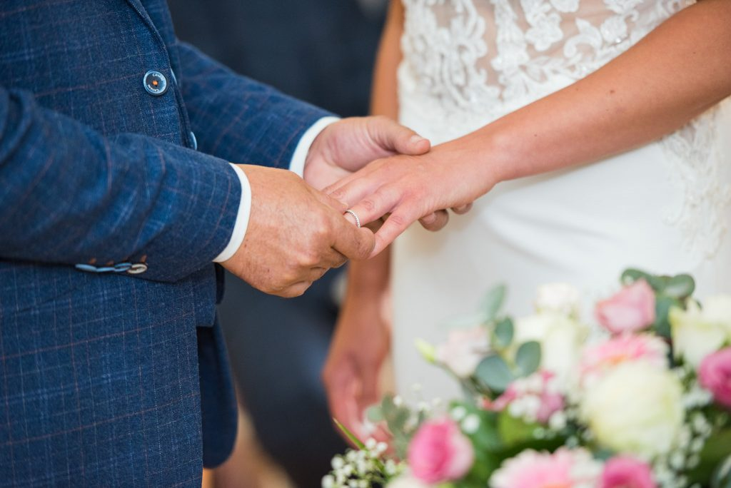 The bride and groom holding hands