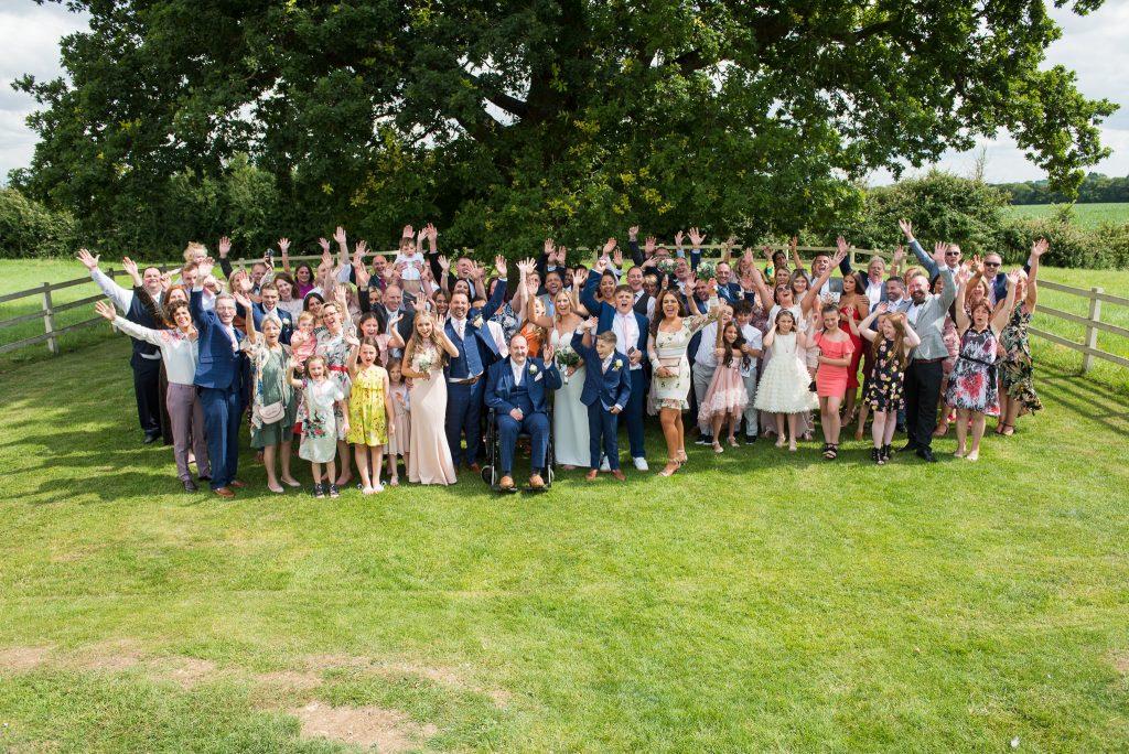 A group shot of wedding guests at Milling Barn