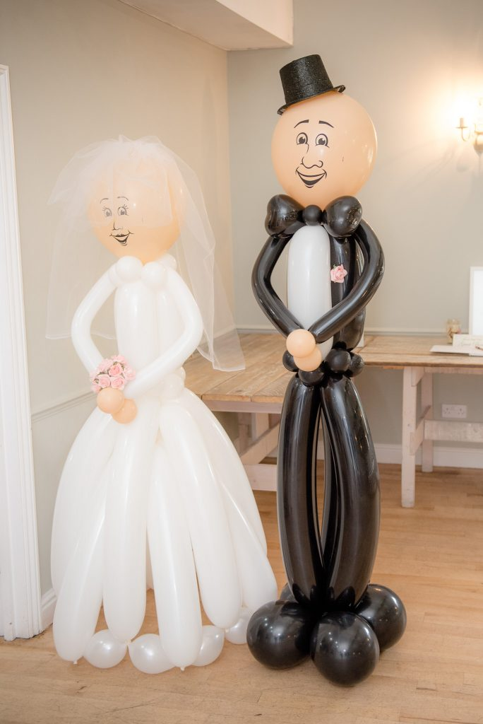 The bride and groom represented in balloons