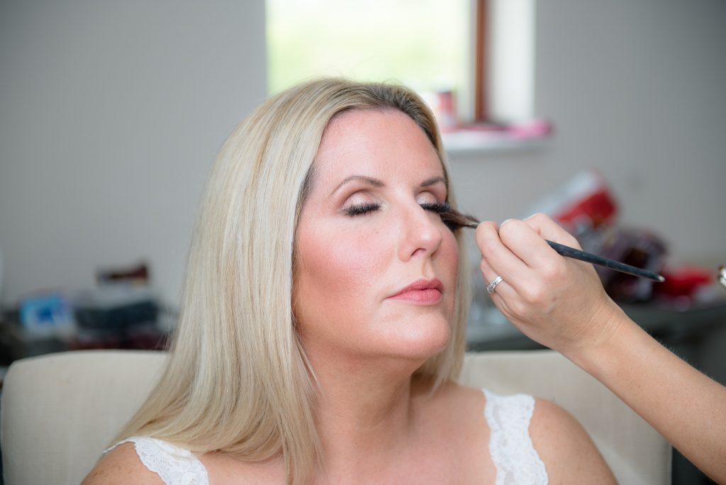 Blusher being applied to a bridesmaid