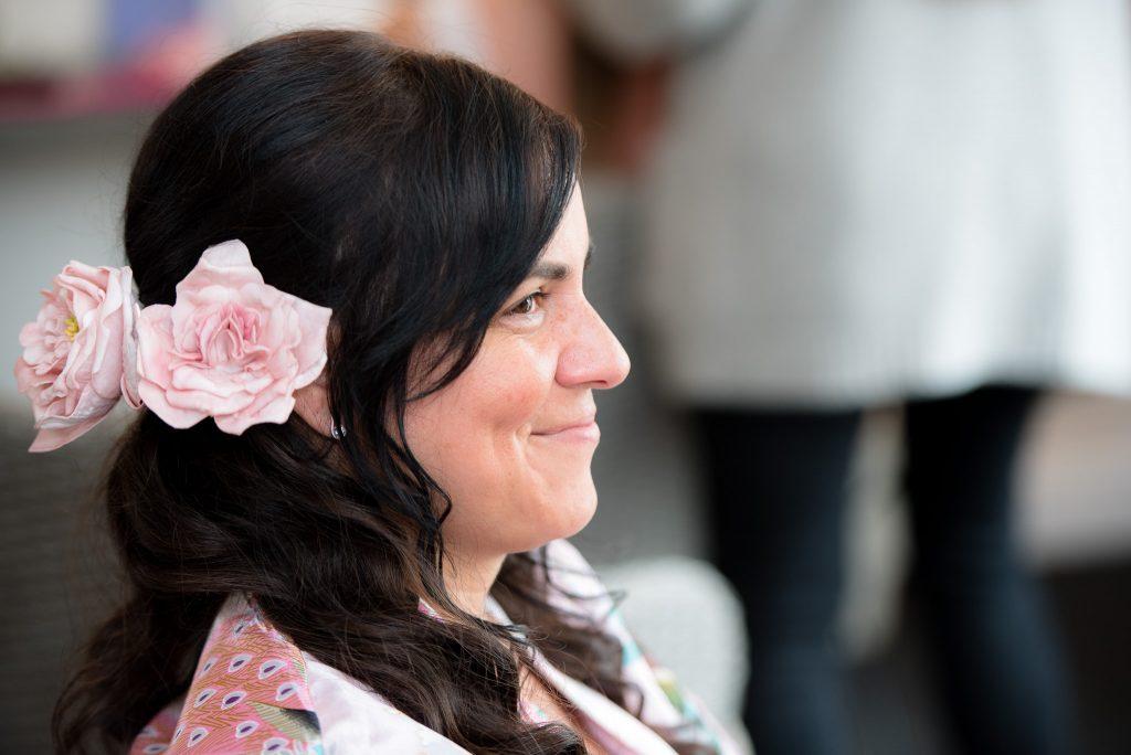 A bridesmaid enjoying the bridal prep